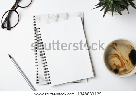 Flat lay composition with notebooks and coffee on white background #1348839125