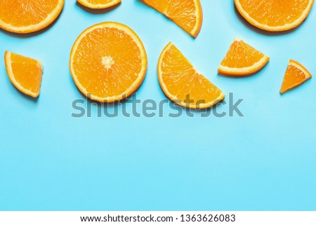 Flat lay composition with orange slices and space for text on color background #1363626083
