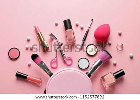 Flat lay composition with products for decorative makeup on pastel pink background #1152577892