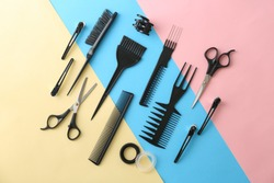 Flat lay composition with professional hairdresser tools on color background