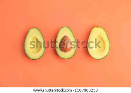 Flat lay composition with ripe avocados on color background