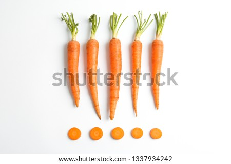 Flat lay composition with ripe fresh carrots on white background