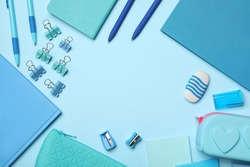 Flat lay composition with stationery on light blue background, space for text. Teacher's day