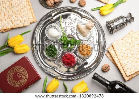 Flat lay composition with symbolic Passover (Pesach) items on color background #1320892478