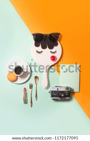 Flat lay conceptual women life style retail objects on coloured background. Objects forming a women's face. #1172177095