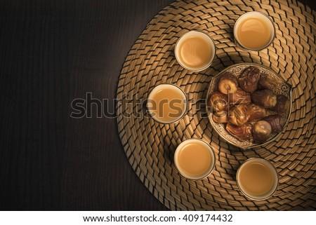 Flat lay dates with Arabian coffee
