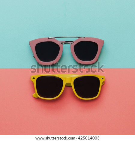 Flat lay fashion set:  two sunglasses on pastel backgrounds. Top view. #425014003