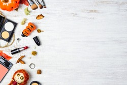 Flat lay Female cosmetics in Autumn and Halloween festival background concept. Top view with copy space for your text.