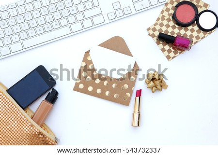 Flat lay. Feminine scene. Wedding background. envelope., laptop.cosmetic  bag, lipstick  #543732337
