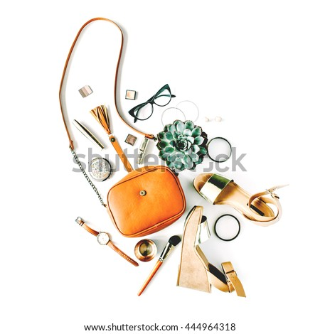 flat lay feminini accessories collage with purse, watch, glasses, bracelet, lipstick, sandals, mascara, brushes on white background.