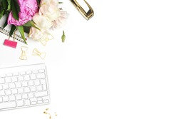 Flat lay. Flower on the table. Keyboard and stapler. Table view. Mock-up background. Peonies