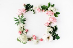 flat lay frame with pink and white roses, branches, leaves and petals isolated on white background. top view