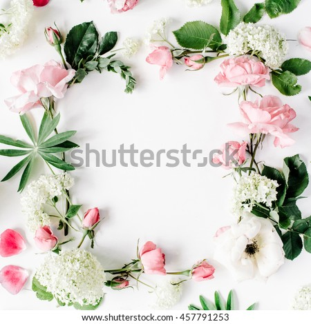 flat lay frame with pink and white roses, branches, leaves and petals isolated on white background. top view #457791253