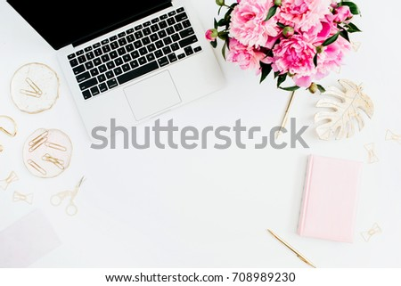 Flat lay home office desk. Female workspace with laptop, pink peonies bouquet, golden accessories, pink diary on white background. Top view feminine background. #708989230