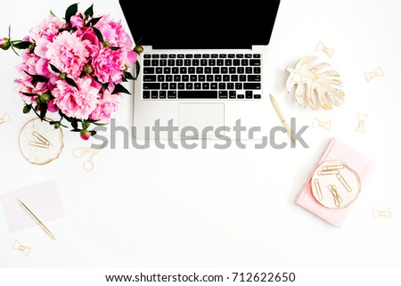 Flat lay home office desk. Female workspace with laptop, pink peonies bouquet, golden accessories, pink diary on white background. Top view feminine background. #712622650