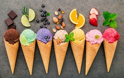 Flat lay ice cream cones collection on dark stone background . Blank crispy ice cream cone with copy space for sweets menu design.