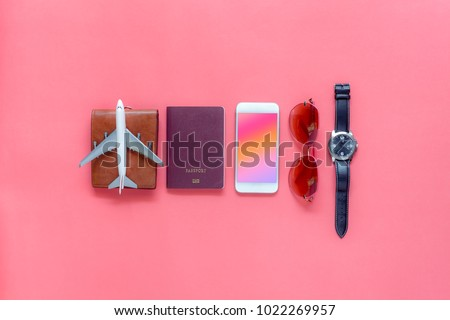Flat lay image of accessory clothing man or women to plan travel in holiday background concept.Mobile phone & passport with many item in vacation season.Table top view several object on pink paper. #1022269957
