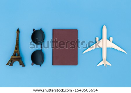 Flat lay image of accessory clothing to plan travel in holiday on blue background, Travel concept, Overhead view of Traveler's accessories, Essential vacation items, Travel concept on blue background.