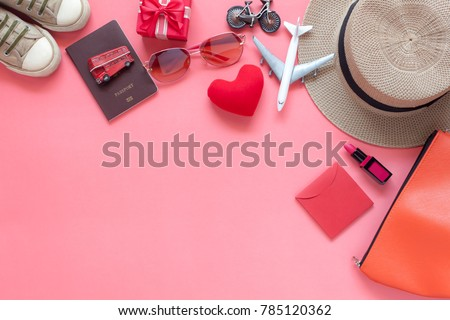 Flat lay image of accessory clothing women to plan travel in valentine's day background concept.Essential items for traveler & backpacker adult or teenage to holidays trip.Space for creative design.