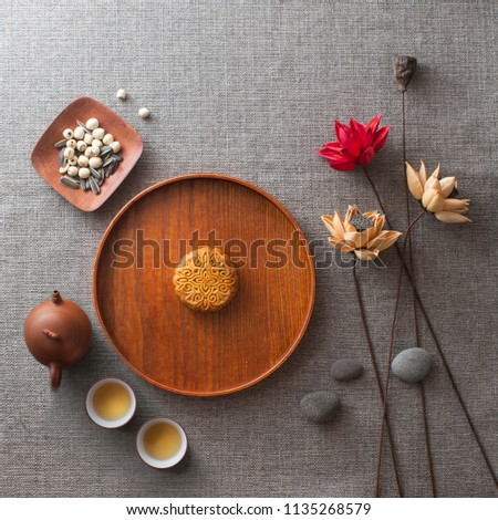 Flat lay mid autumn festival moon cake, snacks and tea still life.