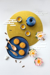 Flat lay Mid autumn festival snack and drink moon cake on moody black textured  background still life image.