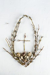 flat lay minimal concept with eggs and  twigs with buds. Spring Easter creative arrangement made of fresh quail eggs and blossoming twigs. Art Happy Easter Holiday, twigs cross