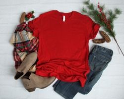 Flat lay mock-up of red t-shirt with Christmas holiday accessori