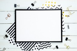 Flat lay mockup with black frame, and office supplies on white wooden background. Top view mockup. Blog template
