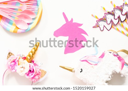 Flat lay. Objects for unicorn themed kids birthday party.