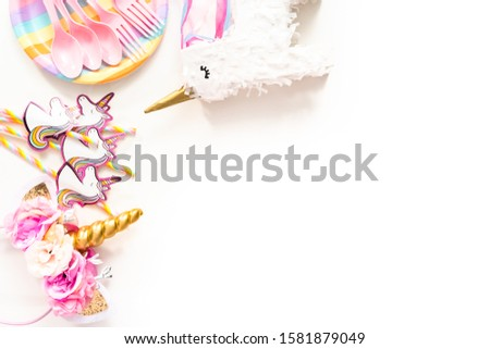 Flat lay. Objects for unicorn themed kids birthday party. #1581879049