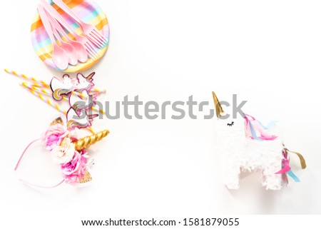Flat lay. Objects for unicorn themed kids birthday party. #1581879055