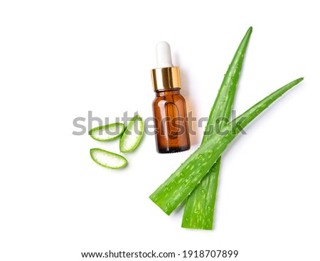 Flat lay of Aloe vera essential oil with fresh leaves and sliced isolated on white background.