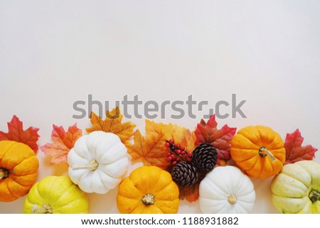Flat lay of autumn harvest concept, pumpkins and autumn leaves on yellow background with copy space #1188931882
