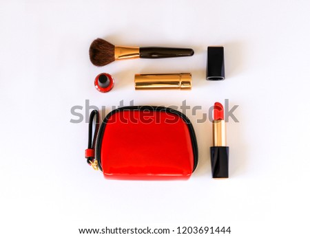 Flat lay of beauty cosmetic make up products in red, black and gold color knolled on white background. Beauty knolling concept. - Shutterstock ID 1203691444