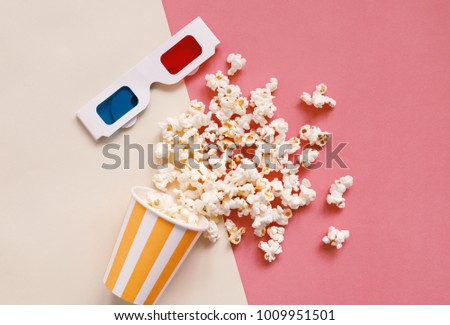 Flat lay of cinema items, 3d glasses and popcorn on colorful bright background with retro style, entertainment concept