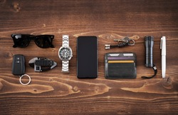 Flat lay of EDC or Every Day Carry items on wooden background