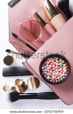 Flat lay of female fashion accessories and pink  handbag on white  background with copyspace #1050746909