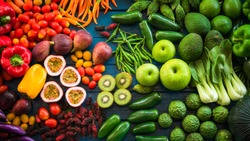Flat lay of fresh  fruits and vegetables for background, Different fruits and vegetables for eating healthy, Colorful fruits and vegetables on blue plank background
