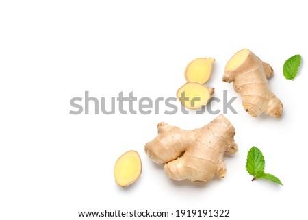 Flat lay of  Fresh ginger rhizome with slices isolated on white background.  Photo stock ©