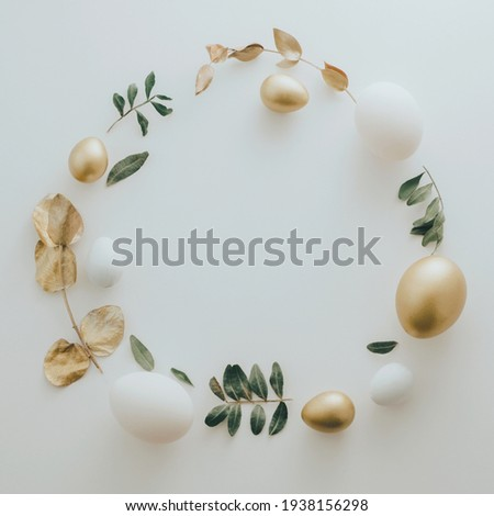 Flat Lay of Golden Easter Eggs ring circle on white background. Easter background or easter concept. Still life, pastel toned
