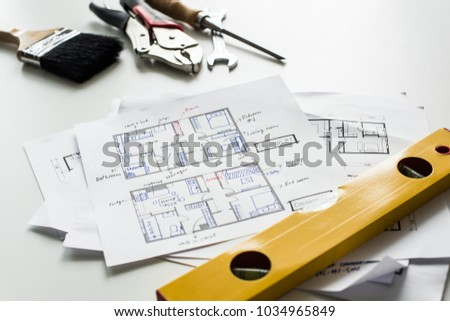 Flat lay of house blueprint isolated on white background
