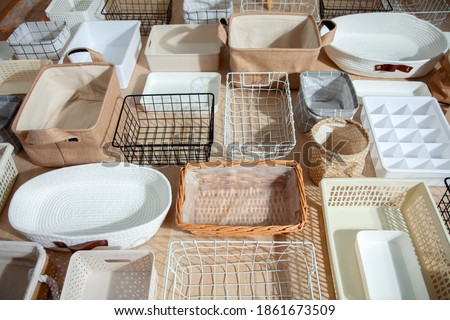 Flat lay of Marie Kondo's storage boxes, containers and baskets with different sizes and shapes for tidying up wardrobe. KonMari method organizer boxes set. Closet organizing concept. Stockfoto ©