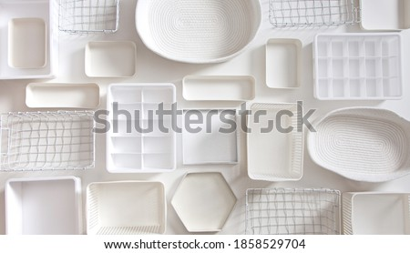 Flat lay of Marie Kondo's white storage boxes, containers and baskets with different sizes and shapes for tidying up wardrobe. KonMari method organizer boxes set. Closet organizing concept. Сток-фото ©