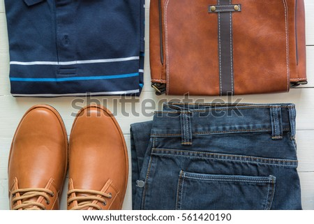 flat lay of men's casual fashion on white wooden floor #561420190