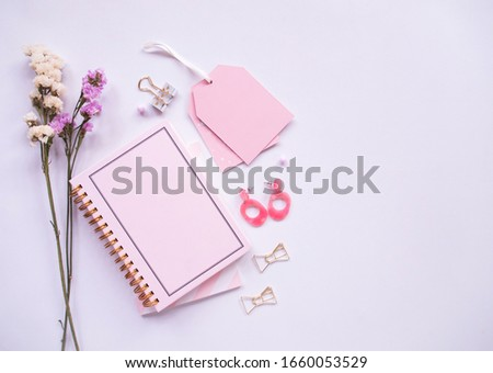 Flat lay of Office table desk, Women's fashion and minimal style on white background with blank space for text. stock photo