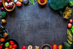 Flat-lay of organic ingredients. Healthy cooking background with delicious vegetables for vegan, gluten free, allergy-friendly, clean eating and raw diet. Vintage concrete background and top view