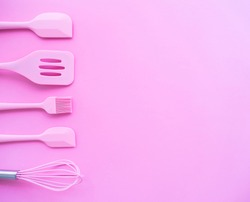 Flat lay of pink kitchen tools and ingredients for cake, cookies, bakery on pink background, copy space.