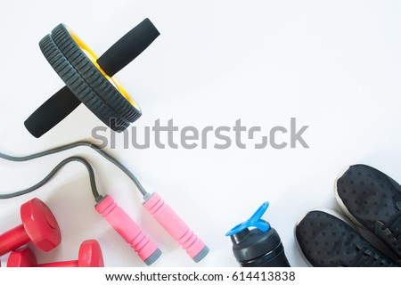 Flat lay of red dumbbells and sport equipment on white background. Sport accessories, Sport equipments, top view
