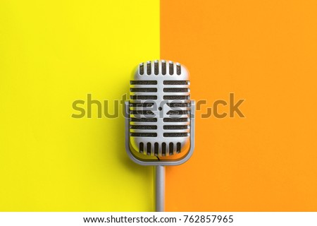 Flat lay of retro microphone on double colorful background. - Shutterstock ID 762857965