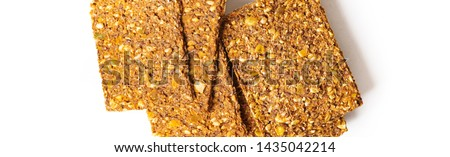 Flat lay of Stack of super-Useful rye multi-grain whole-grain crackers with different seeds on isolated background with space for text. superfoods healthy organic products.Long banner.